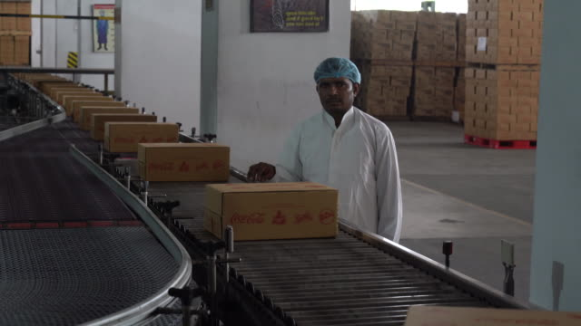 operations at the moon beverages ltd cocacola happiness factory in noida uttar pradesh india on tuesday march 19 2019 coke's hunt for healthconscious... - abfüllanlage stock-videos und b-roll-filmmaterial