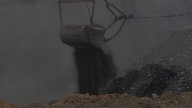 operations at the peabody energy wild boar surface mine lynnville, indiana, u.s., on tuesday, april 5, 2016 shots footage of large crane excavating... - burning coal stock videos & royalty-free footage