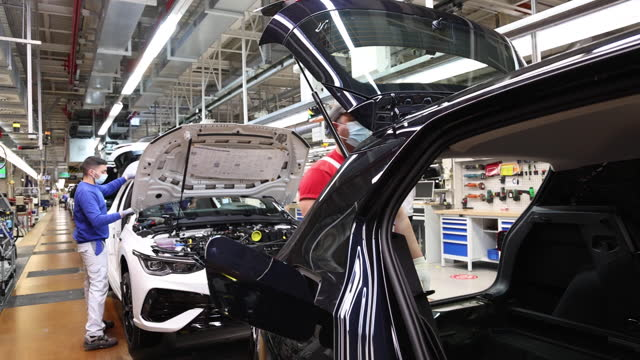stockvideo's en b-roll-footage met operations at volkswagen factory as company makes covid self-tests available, in wolfsburg, lower saxony, germany on tuesday, april 20, 2021. - testkit