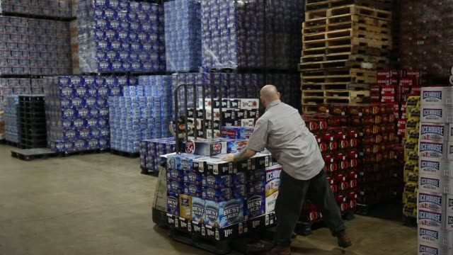 operations in the warehouse of baumgarten distributing co in peoria illinois us on thursday sept 17 2015 shots wide shots of the warehouse show... - anheuser busch inbev stock videos and b-roll footage