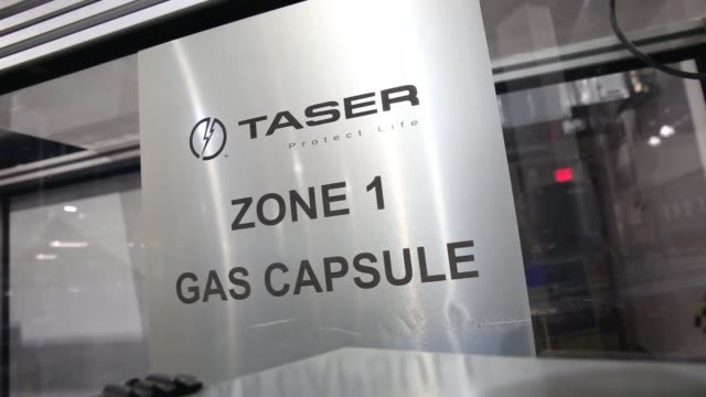 Operations Inside Taser International Inc's Manufacturing Facility in Scottsdale Arizona US on April 23rd 2015 Shots Close up shot of a sign reading...