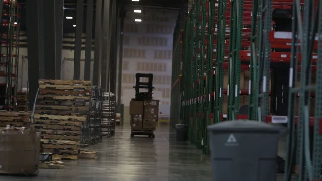 Operations inside the Overstockcom distribution facility in Salt Lake City UT on April 26 2016 Shots shots of man with forklift moving down hall man...