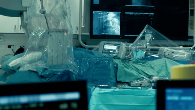 operative room. monitor transmiting process of injection into blood vessel - human vein stock videos & royalty-free footage