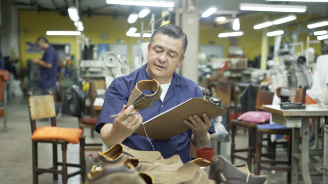 Operator doing inventory in a shoe factory of the shoes produced