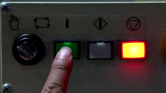 operator is push on power in control unit - control panel stock videos & royalty-free footage