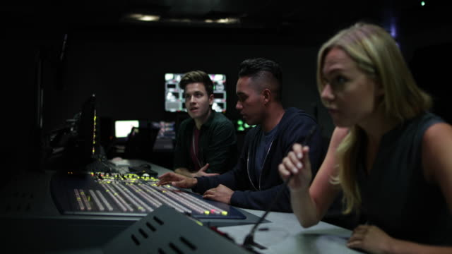 operators in a control room at a television studio - crew stock videos & royalty-free footage