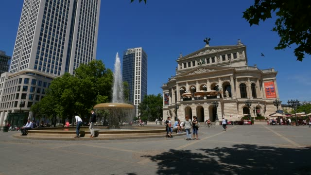 opernplatz with alte oper, old opera house, and opernturm, frankfurt am main, hesse, germany - オペラ座点の映像素材/bロール