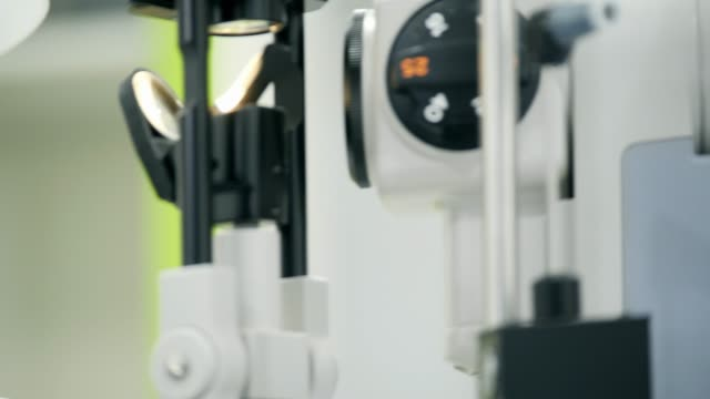ophthalmologist checks woman's eyes. - ophthalmologist stock videos and b-roll footage