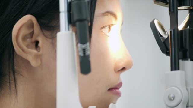 ophthalmologist checks woman's eyes.close up. - eyesight stock videos & royalty-free footage