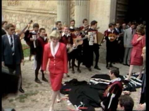 oporto ms charles standing by musicians sof as diana pull back as rl carefully walking over students capes on the ground ts charles and diana barely... - king royal person stock videos & royalty-free footage