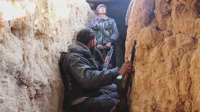 opponent forces dig tunnels and ditches to defend themselves against regime forces in jobar district of damascus syria on 7 april 2015 - bulldozer stock videos & royalty-free footage