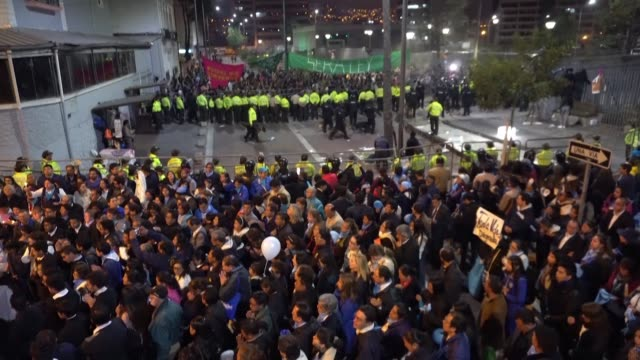 opponents and supporters of abortion rights gather in quito after the ecuadorean congress voted against the decriminalization of abortion in cases of... - ecuador stock videos & royalty-free footage
