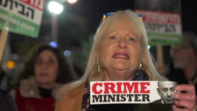 opponents and supporters of israeli prime minister benjamin netanyahu take to the streets after the country's attorney general said he intended to... - benjamin netanyahu stock videos & royalty-free footage