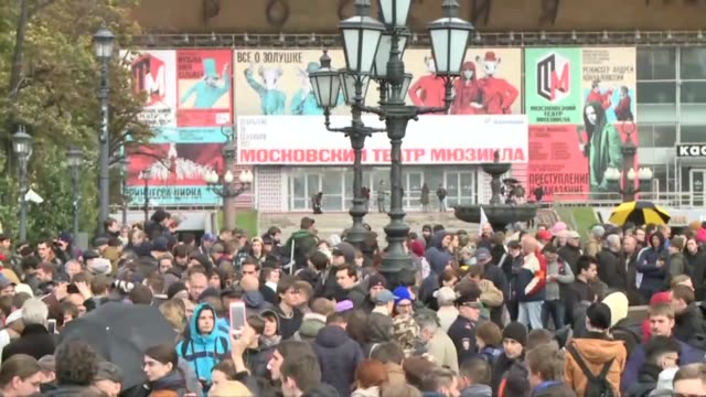 Opponents of Russian president Vladimir Putin gather in Moscow on his 65th birthday