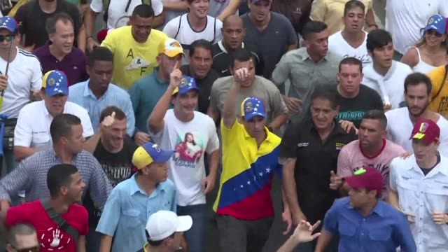 Opponents of Venezuela's leftist President Nicolas Maduro staged mass street rallies Wednesday with opposition leader Henrique Capriles claiming the...