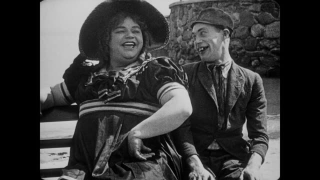 1917 opportunist man (al st john) crawls away from crying woman to flirt with man (fatty arbuckle), who is disguised as woman - fatty arbuckle stock videos and b-roll footage