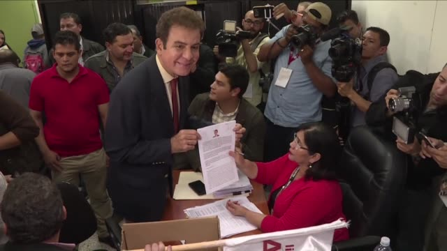 Opposition candidate Salvador Nasralla for the presidential race in Honduras presents a document asking for the annulment of results of the still...