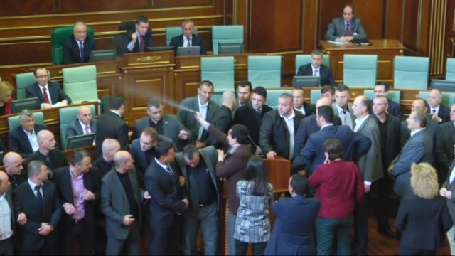 opposition lawmakers in kosovo fired tear gas and pepper spray in parliament on tuesday the latest such incident in a deepening political crisis over... - pristina stock videos and b-roll footage