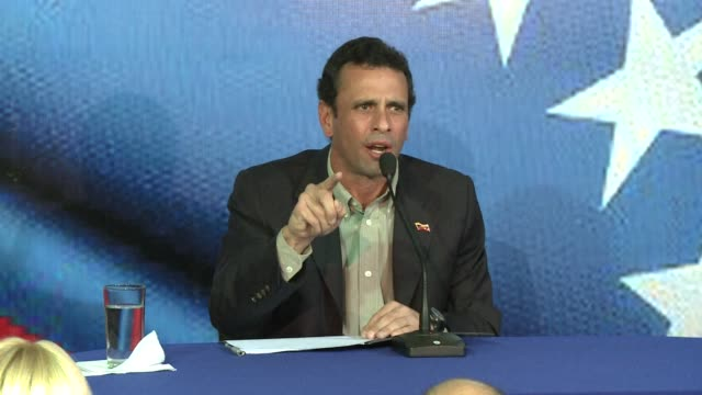 Opposition leader Henrique Capriles enters the race to succeed Hugo Chavez in the April 14 election accusing the late Venezuelan leaders chosen...