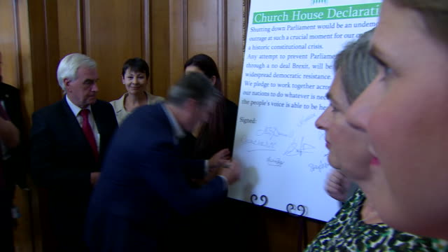 opposition mp's signing a pledge to do everything they can to stop a nodeal brexit - john mcdonnell politician videos stock videos & royalty-free footage