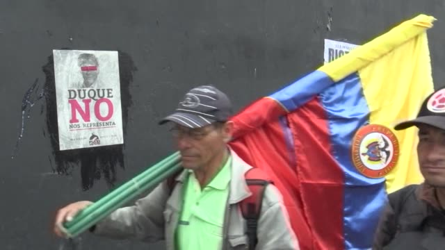Opposition protesters in Bogota rally against newly elected President Ivan Duque as he is sworn into office