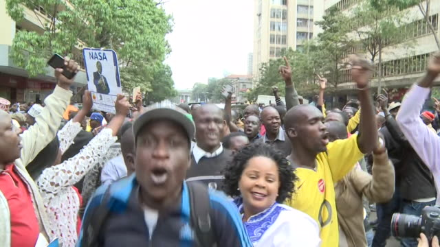 Opposition supporters celebrating on the streets of Nairobi Kenya after the Supreme Court orders a rerun of the Presidential election after the...