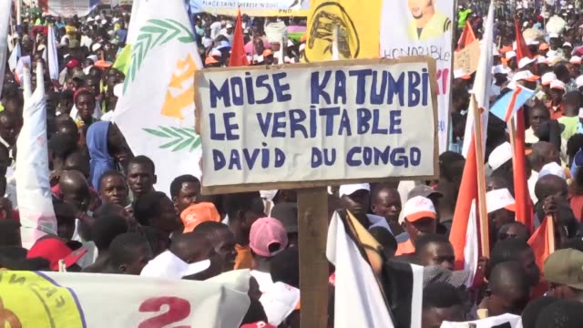 opposition supporters rally in kinshasa calling for the election of exiled opposition leader moise katumbi - esilio video stock e b–roll