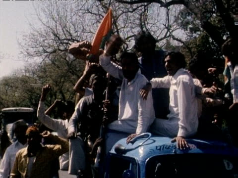 opposition supporters riding trucks and shouting celebrate defeat of congress party delhi mar 77 - dalit stock videos and b-roll footage