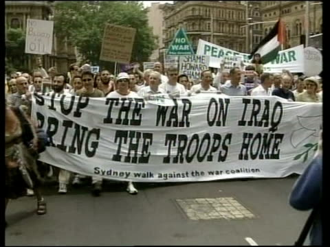 opposition to iraq war continues itn sydney demonstrators towards with large antiwar sign tgvs large crowd of peace protesters along in demonstration... - protestor stock videos & royalty-free footage