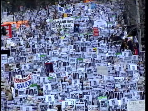opposition to iraq war continues lib embankment huge crowd of antiwar demonstrators with placards pull out - protestor stock videos & royalty-free footage