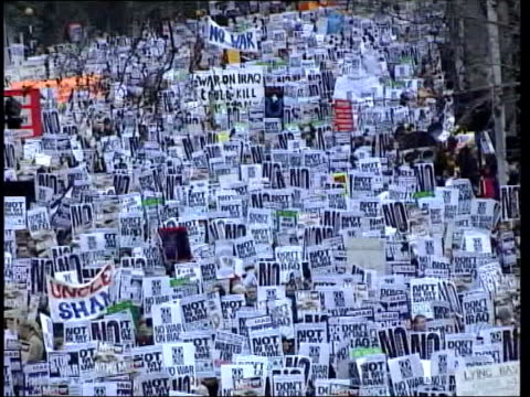 opposition to iraq war continues lib london embankment huge crowd of antiwar demonstrators with placards pull out - protestor stock videos & royalty-free footage
