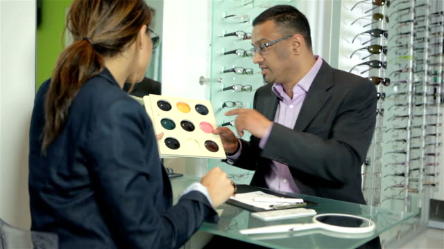 Optician demonstrating tinted lenses