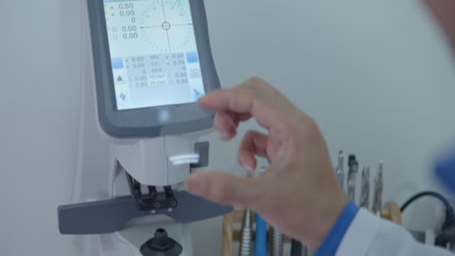 optician measuring and preparing glasses - lens optical instrument stock videos & royalty-free footage