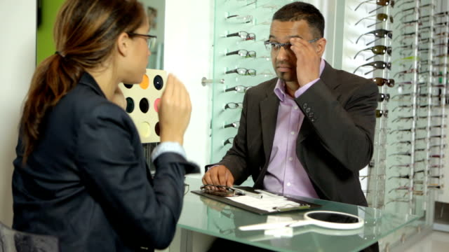 Optician with client