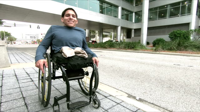 optimistic young man, amputee in wheelchair - amputee stock videos & royalty-free footage