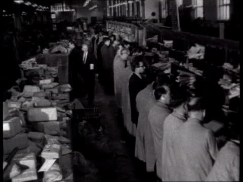 mount pleasant sorting office post office workers sorting mail by hand - archives stock videos & royalty-free footage