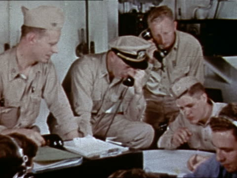 1943 or 1944 wwii us navy officer and personnel talking on phones in control room of uss yorktown - 将校点の映像素材/bロール
