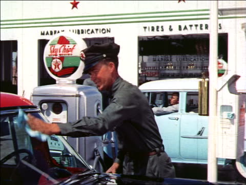 1959 or 61 service station attendant wiping windshield of car at gas pump / educational - gas station attendant stock videos and b-roll footage