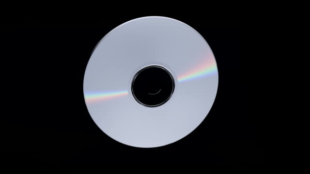 dvd or cd flying into player including loop and alpha/matte - disk stock videos and b-roll footage