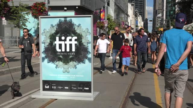 TIFF or Toronto International Film Festival pedestrians enjoying the new vehicle closed Festival Street Festival Street is the temporary name given...