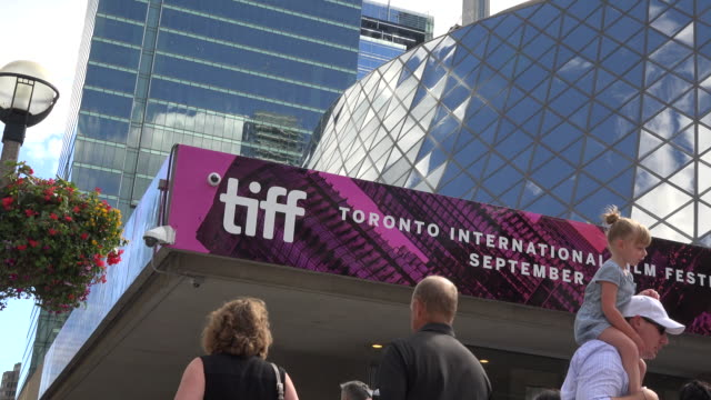 TIFF or Toronto International Film Festival Zoom in to event signage on top of the Roy Thompson Hall CN Tower and other downtown buildings appear in...