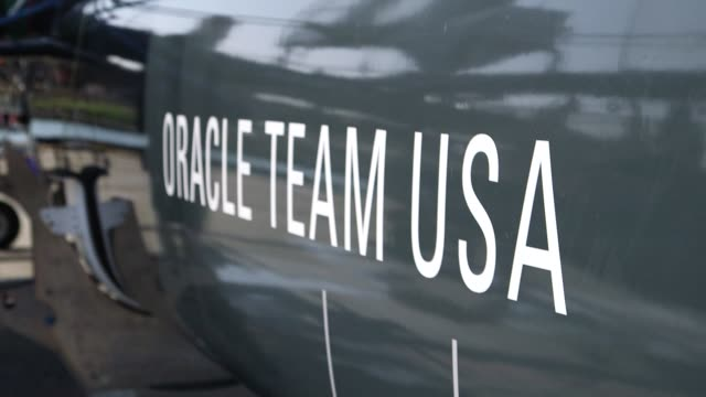 oracle team usa sailboat at the teams headquarters in san francisco california us on march 26 close up of an america flag on the oracle boat with a... - oracle corporation stock-videos und b-roll-filmmaterial