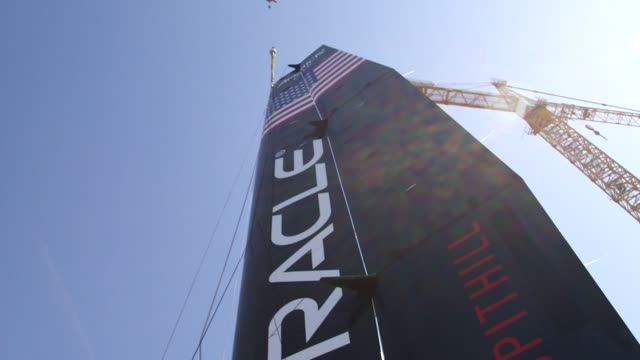 oracle team usa sailboat is lowered into the ocean at the teams headquarters in san francisco california us on march 26 wide shots and close ups of... - oracle corporation stock-videos und b-roll-filmmaterial