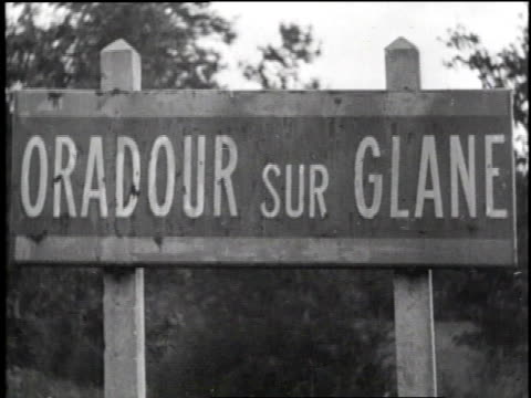 vídeos de stock, filmes e b-roll de oradour sur glane in ruins / oradour sur glane signpost / destroyed buildings / corpses on ground / corpse on ground / burned hotel / burned... - tremido