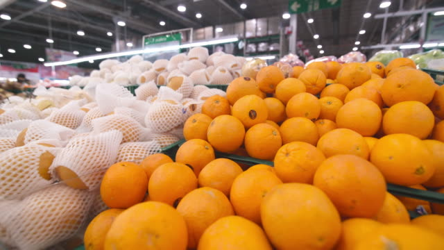 orange and fruit at supermarket - organic stock videos & royalty-free footage