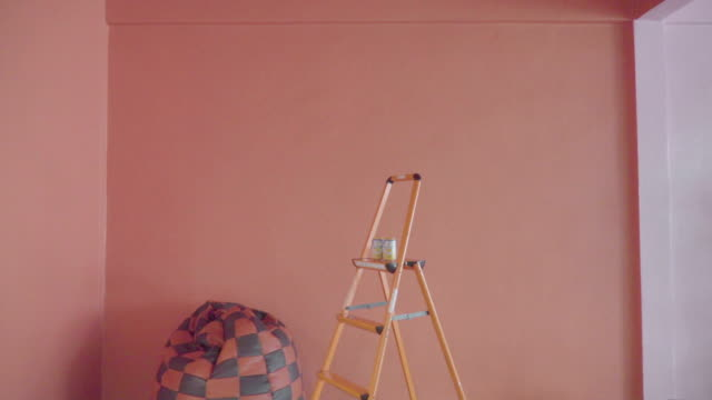 orange and pink room with props, photography studio - home showcase interior stock videos & royalty-free footage
