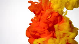 Orange and yellow watercolor ink mixed in water on a white background. Abstract background.