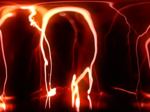 orange arc reflections in tube - tesla coil stock videos and b-roll footage