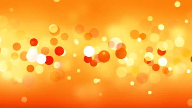 orange background (loopable) - orange background stock videos & royalty-free footage