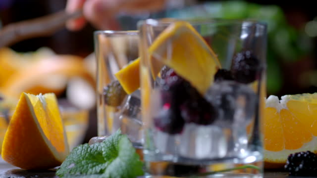 orange blackberry punch - garnish stock videos & royalty-free footage